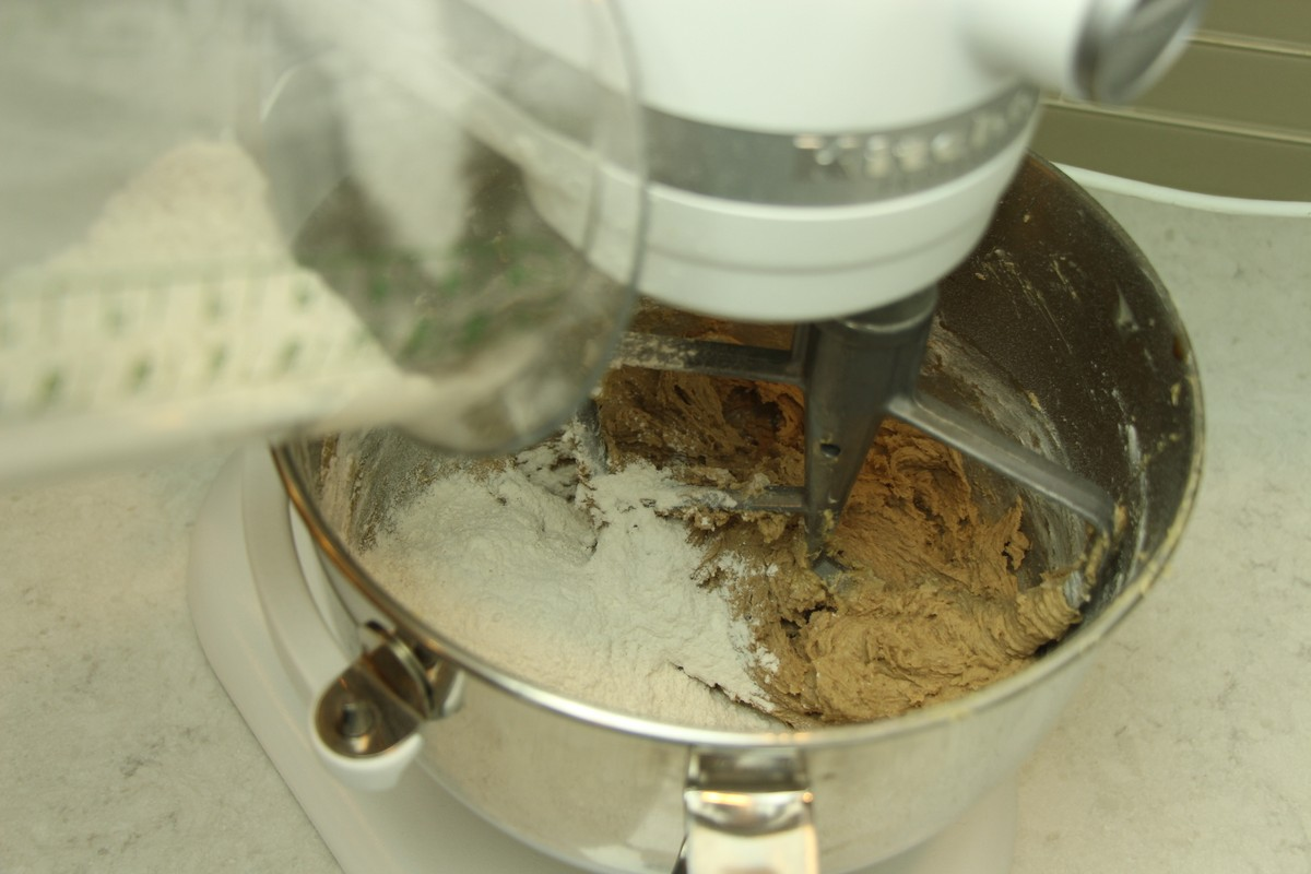 Adding flour to cookie batter, using KitchenAid stand mixer.