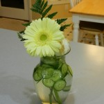 Adding Cucumbers to Flowers in Vase