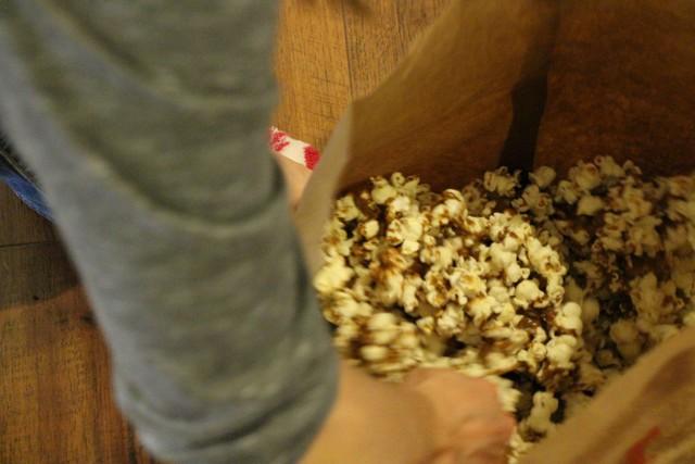 Caramel Corn Recipe, stirring popcorn with caramel sauce