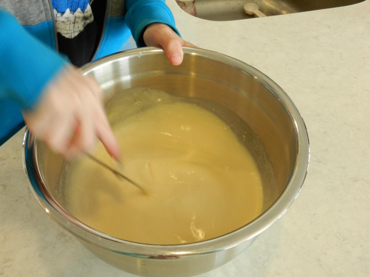 Making Norwegian pancake batter, mixing in eggs