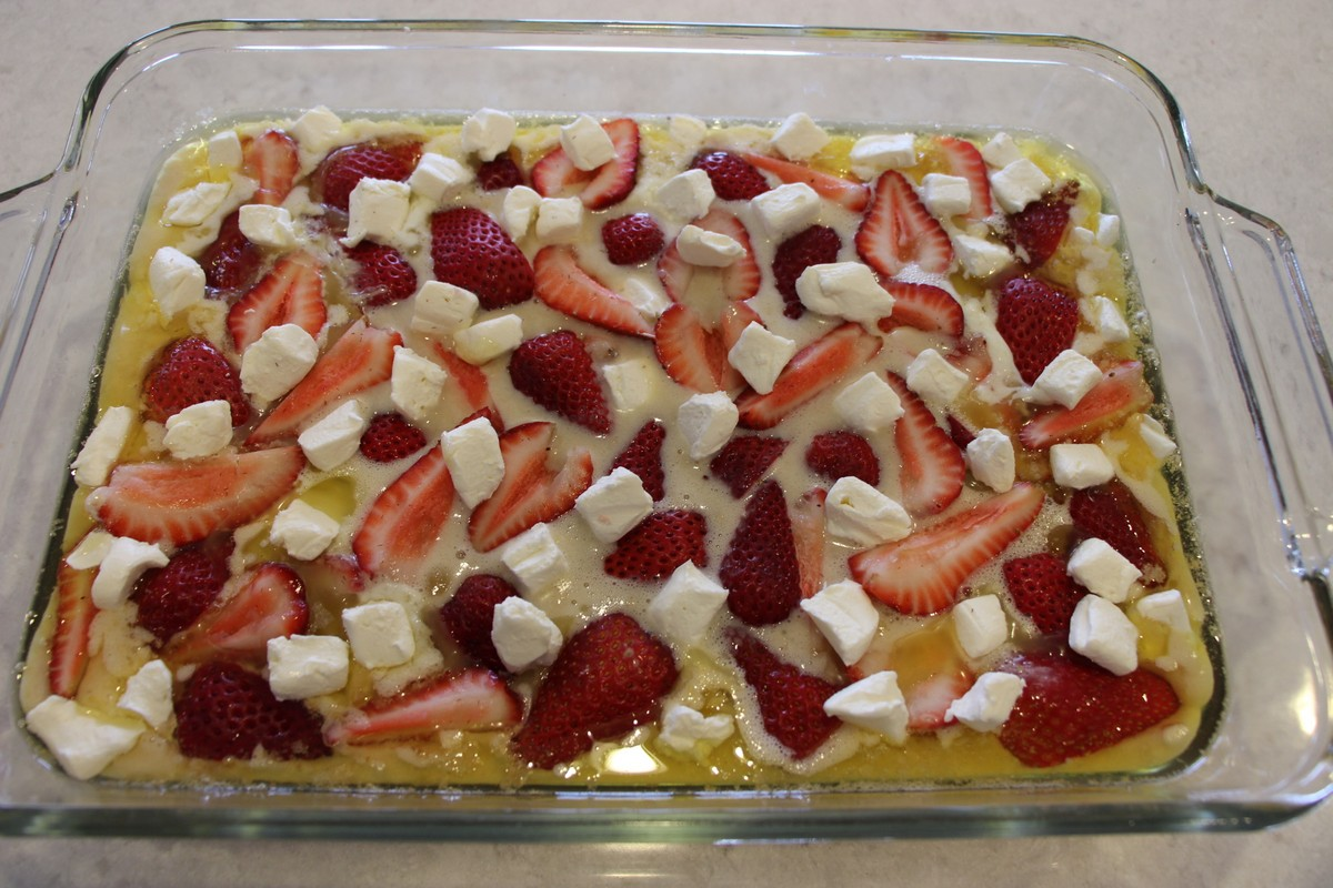 Strawberry Cream Cheese Cobbler, recipe with picture tutorial. Easy and delicious! Can adjust amount of berries and cheese to your own liking.