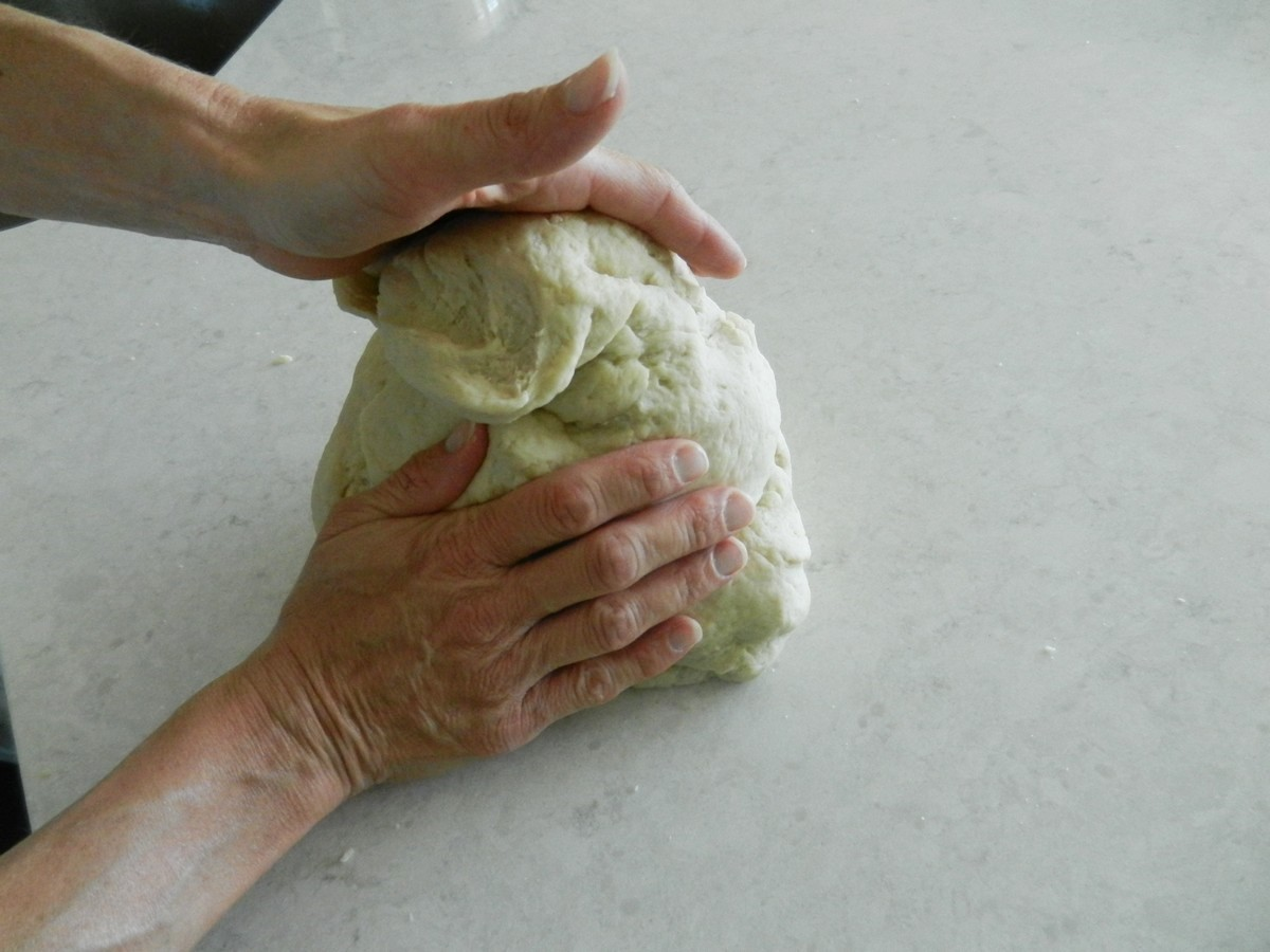 Kneading dough to make soft, flavorful flour tortillas. Recipe and pictures.